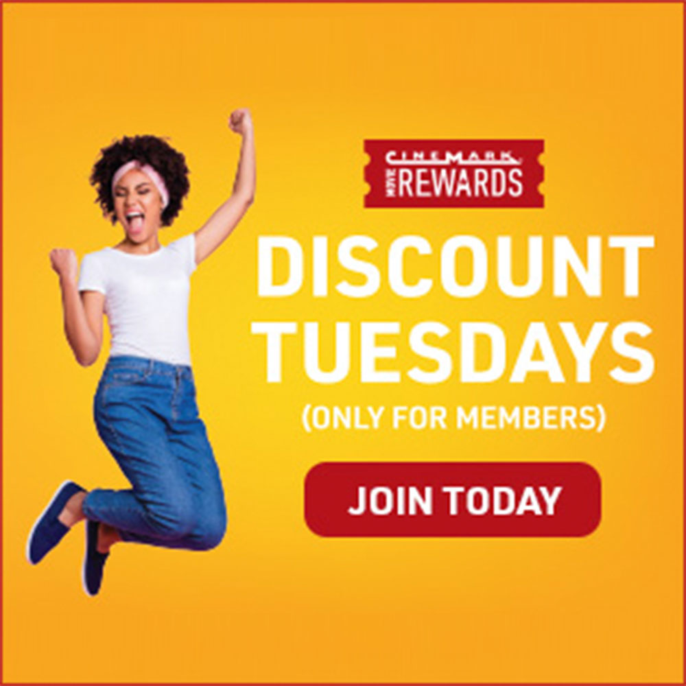 Image of woman jumping on a yellow background because of Discount Tuesdays