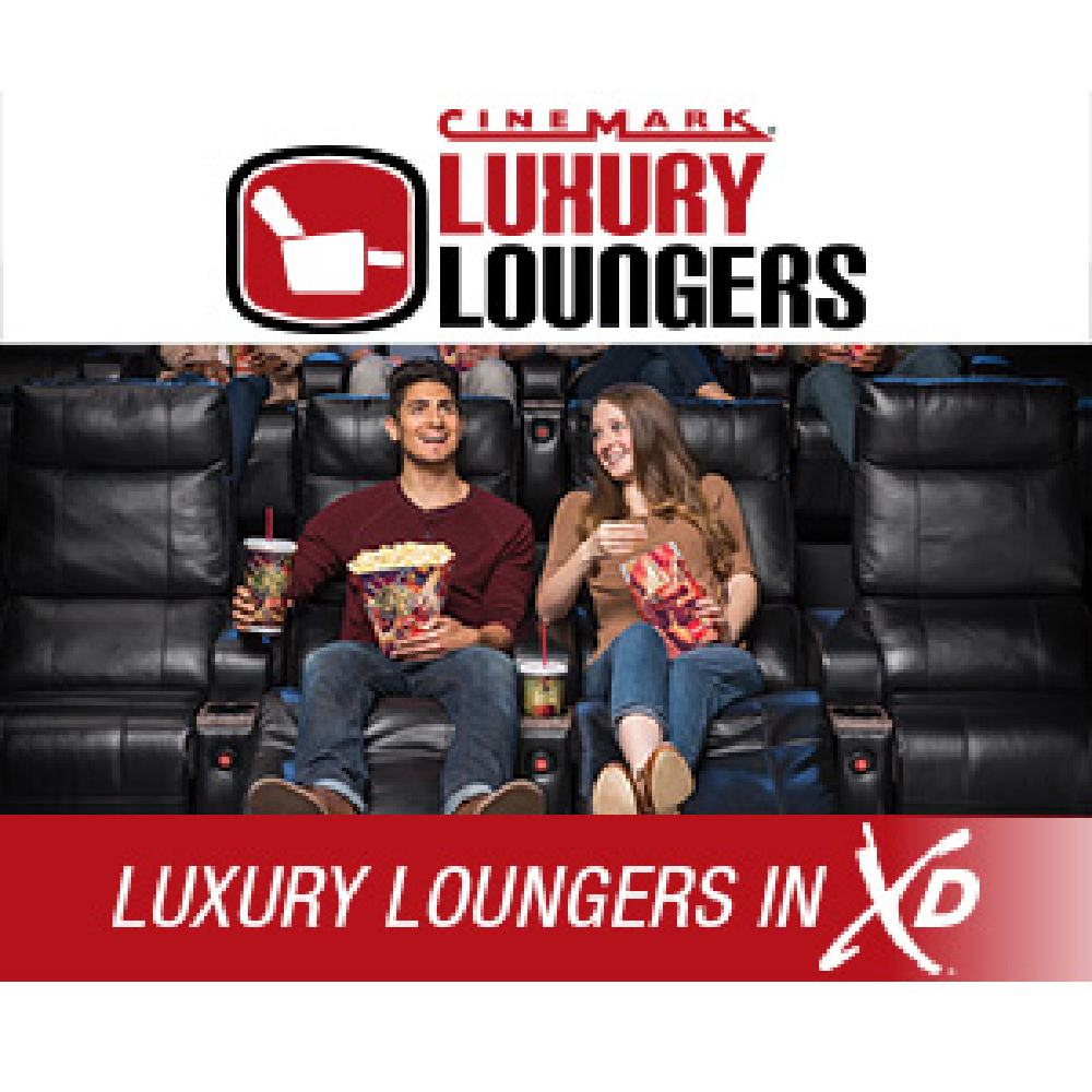 Cinemark promoting their luxury lounge chairs with a man and woman enjoying their time at the movies with snacks sitting in those seats.