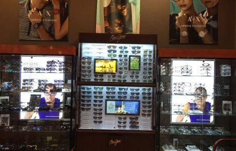 Glasses and sunglasses on display in display cases in a classes store.