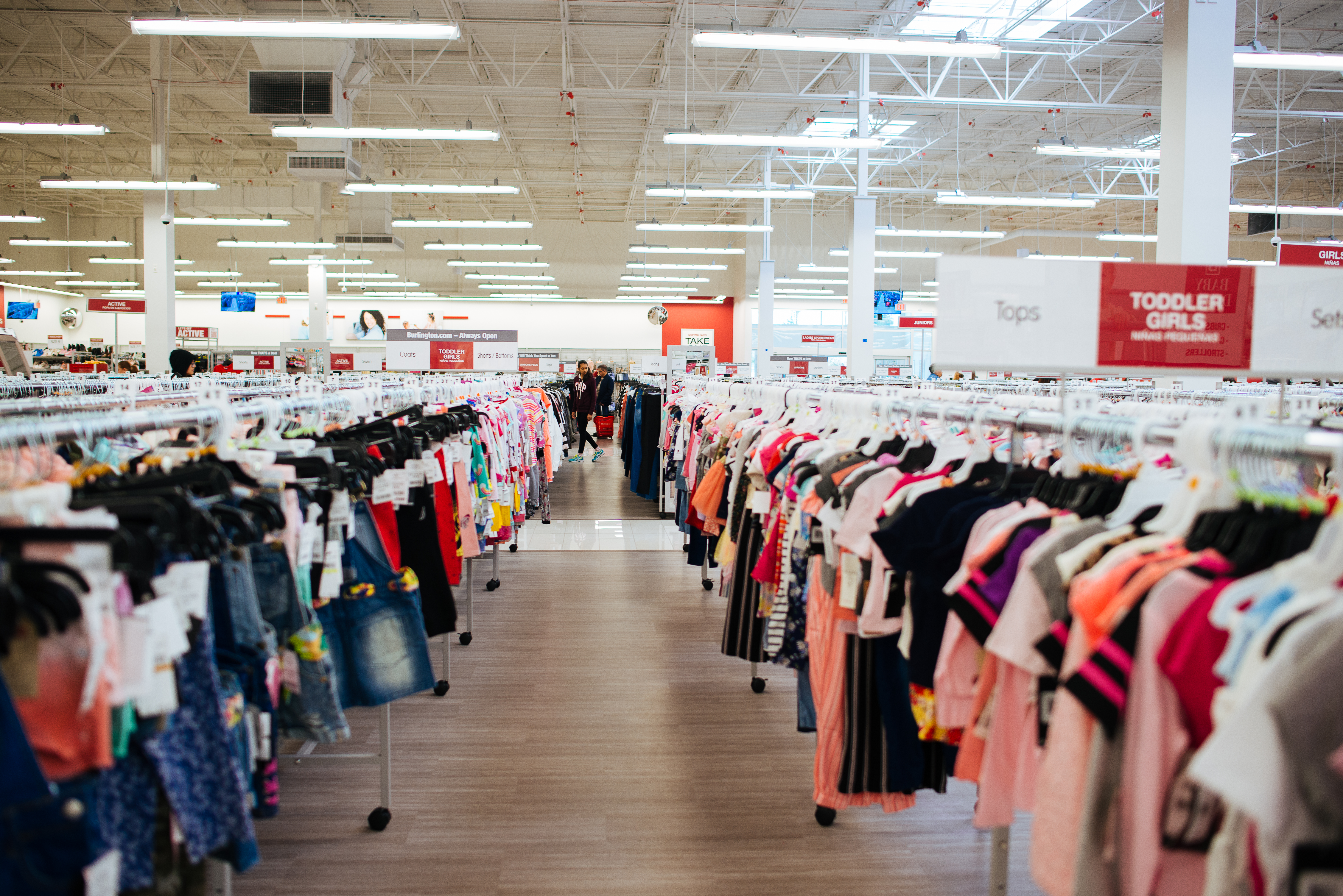 Aisles of clothes inside Burlington.