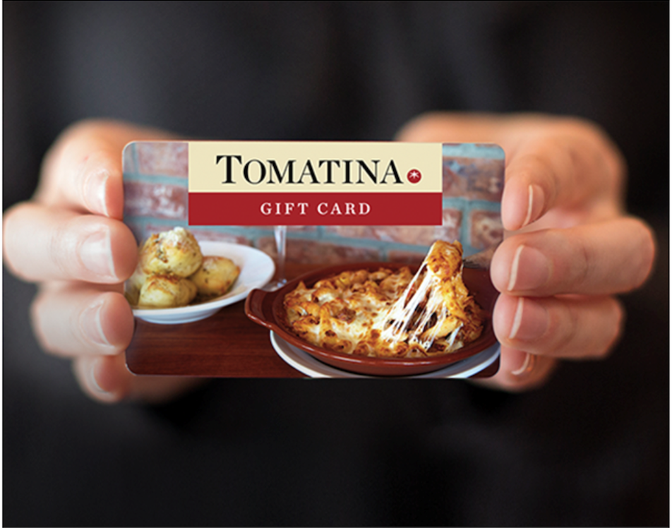 Hands holding a Tomatina gift card