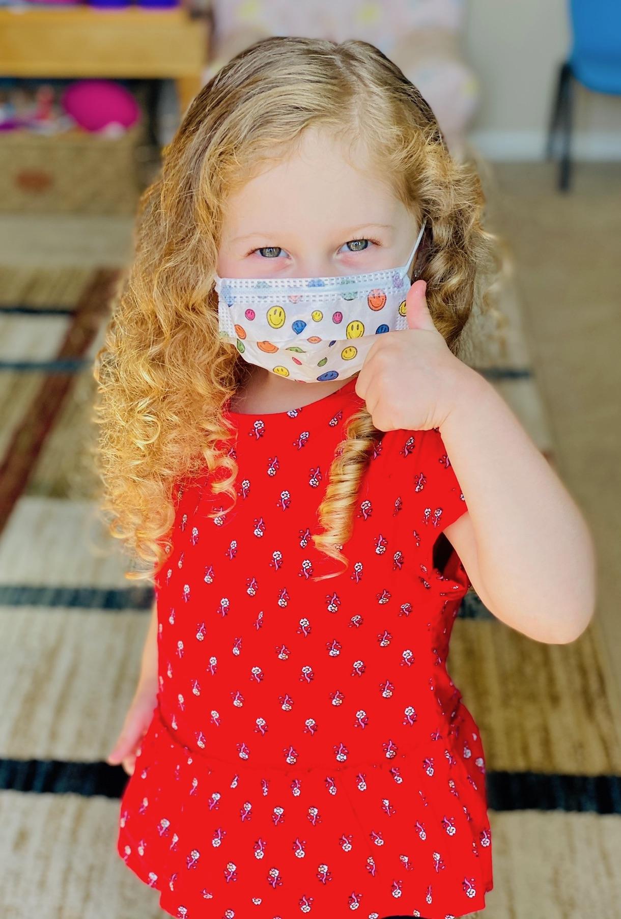 kid wearing a mask