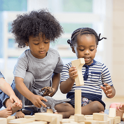 Small Children playing with blocks.